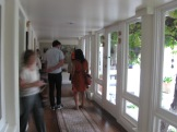 The hallway runs along the front of the house with small rooms opening from it. The roof is rather low