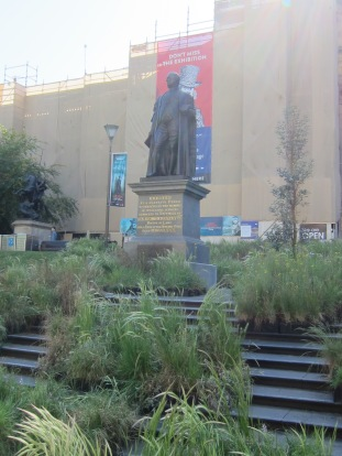 Good old Sir Redmond is surrounded by shrubbery
